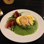 breast of chicken served on a bed of mashed potato with spinach sauce....nicely presented and ta