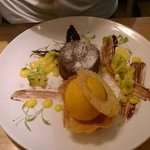 Melting chocolate pud with mango sorbet and pineapple salsa
