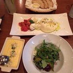 On the left polenta with Gorgonzola cheese that was ok,arugula beet salad that was delicious and