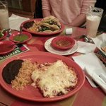 Enchiladas with Swiss cheese, and Tacos, both with beef steak, rice and mashed beans.