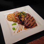 Grilled Miso Beef served with a plum vinegarette, seared sesame rice, and a spicy Asian slaw