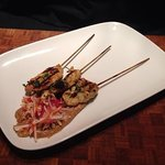Yellow curry chicken skewers with Hoisin peanut sauce and an Asian slaw