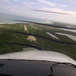 Landing in Holbox, dirt strip lined with sea shells.