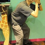 life-like wax figure taking YOUR picture