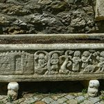 Medieval relief on a planter in front of the 13th century church in Minerve