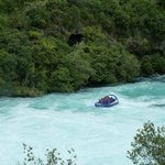 A jet boat zooms up to the base of the falls