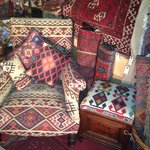 Traditionally reupholstered chair covered in kilim