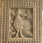 Wooden carving on the column depicting Garula, a mythical bird