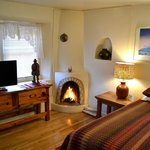 Zia room features a real wood burning kiva fireplace to create a romantic Santa Fe experience.