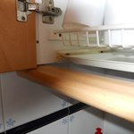 dish drainer in kitchen cupboard