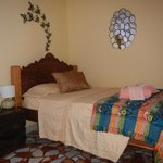 Main bed in our Volcano Family Room in the Lodge (fitted with orthopedic mattress)