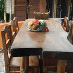 Locally hand made tables are available for communal use