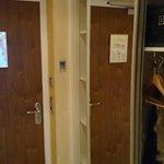 wardrobe and shelf area for clothing