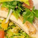 dinner entree sautéed fish over seasonal vegetables
