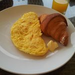 Breakfast of omelette with croissant