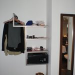 Storage shelves, hanger rack (no dresser or storage drawers)