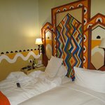 The cozy bed and wall paintings