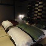 1階露天風呂付客室、ベッド