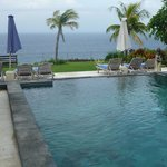 sitting on pool deck looking to ocean