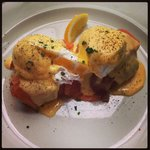 Eggs Benedict with smoked salmon on bubble and squeak cakes