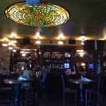 Beautiful stained glass ceiling light & amazing woodwork on the bar