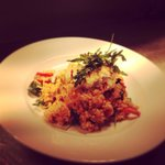 Red pepper and goats cheese risotto infused with paprika and rocket