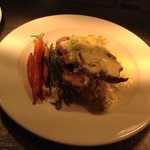 Pork loin steak with a creamed leek sauce, mustard mash and baby veg