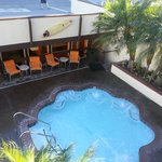 Jacuzzi, pool is on the left