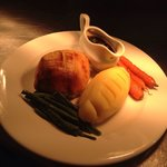 Individual beef Wellington, creamed mash, Madeira sauce and baby veg
