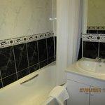 Bath, shower and wash hand basin.