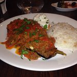 Karniyarik - Aubergine stuffed with minced lamb, in tomato sauce. Served with rice and yoghurt.