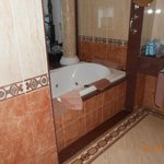 Bath between bathroom and bedroom