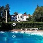 Lovely outdoor pool and grounds right on the lake
