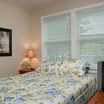 Suite 1 is a 1 bedroom with queen bed, living room, full bath, and private deck on first floor.