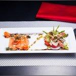 chef's creation; smoked salmon with asparagus and seranoham