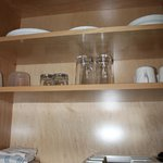 glasswear in kitchenette cabinet