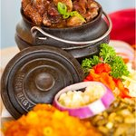 OXTAIL SERVED WITH VEGETABLES AND SAMP