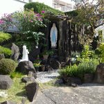 Grotto with Our Lady and Bernadette statues outside Church