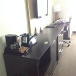 Desk with coffee maker, mini fridge, and microwave