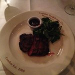 Rare house cut steak, with red wine and port sauce, and watercress.