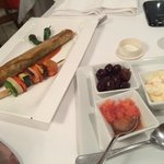 Olives, garlic mayonnaise and grated gresh tomato served with assortment of bread