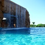 grotto and pool bar behind waterfall