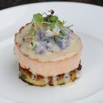 Roulade of Salmon, with creamy cauliflower, potato galette, and jura wine sauce