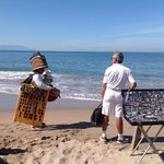vendor selling his goods on the beach
