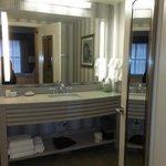 Vanity area, toilet behind door shower to left-neat under vanity night lite