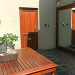 entry with tub and rainskowers outside