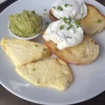 Poached eggs on toast with guacamole and haloumi
