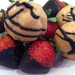 Cream puffs and chocolate covered strawberries.