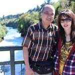 With my wife enjoying the blue and sunny sky at Huka Falls