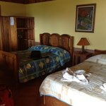 room with 2 double beds